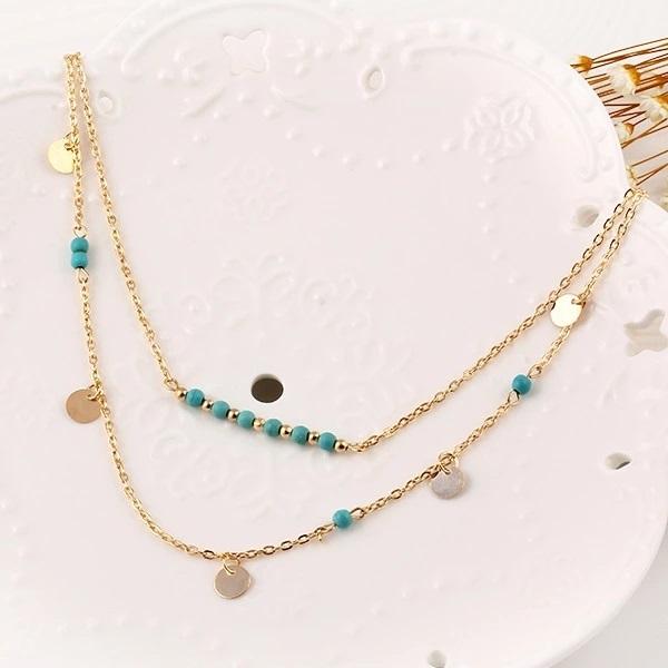 collier doré perles bleues