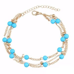 Chaine de cheville triple chainage dorée avec perles turquoises