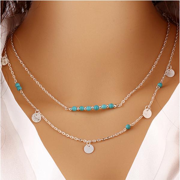 Collier double chaine avec pampilles et perles bleues